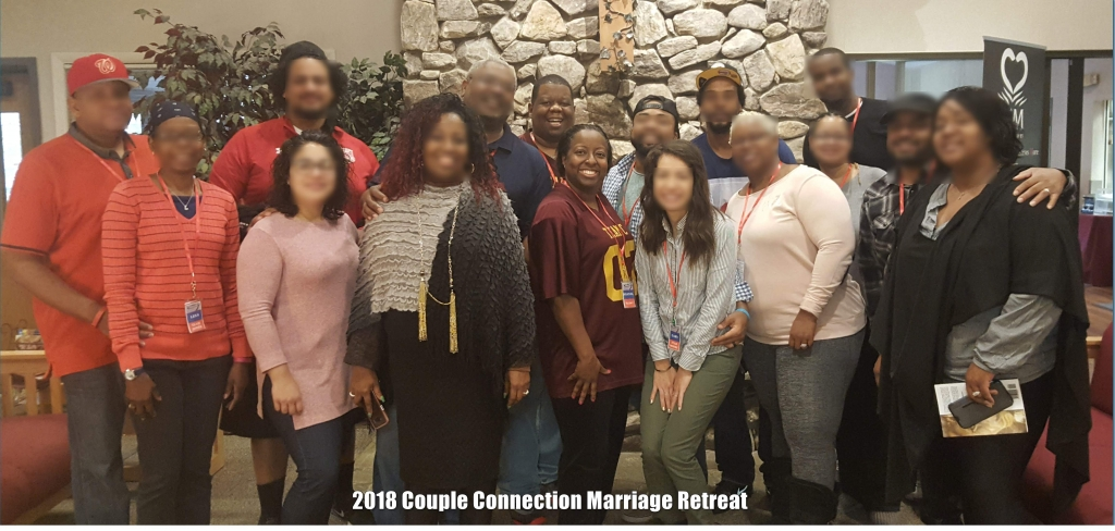2018 Couple Connection Marriage Retreat picture by the fireplace